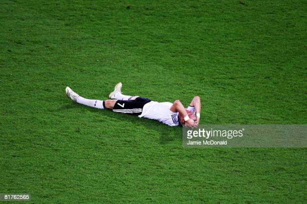 Bastian Schweinsteiger of Germany holds his head after the UEFA EURO 2008 Final match between Germany and Spain at Ernst Happel Stadion on June 29,...