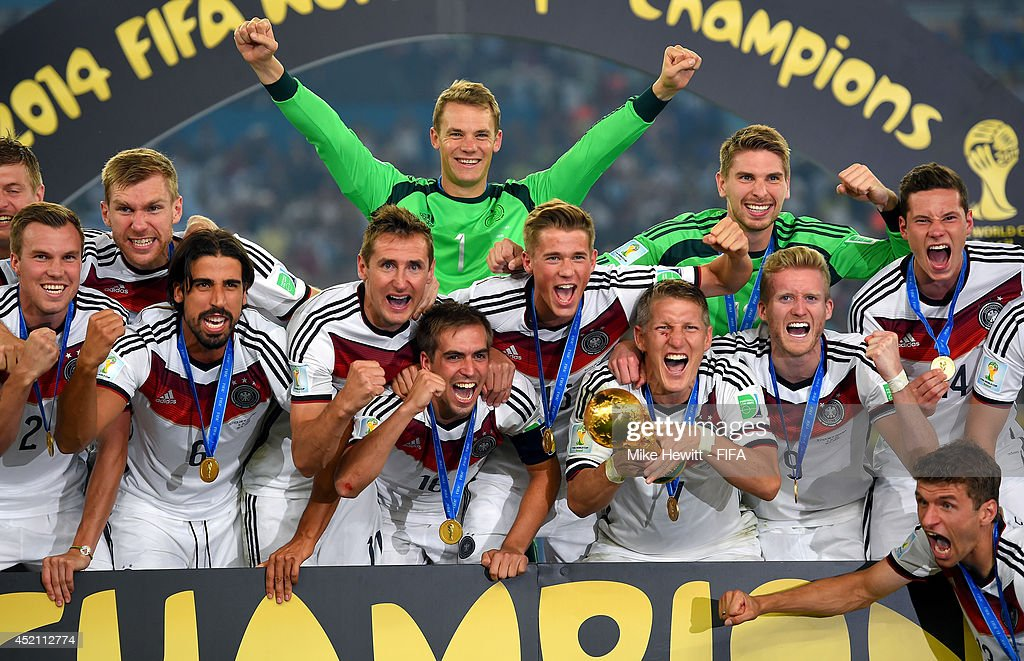 Bastian Schweinsteiger of Germany holds the World Cup while posing for photographs with his teammates after the 2014 FIFA World Cup Brazil Final match between Germany and Argentina at Maracana on July 13, 2014 in Rio de Janeiro, Brazil.