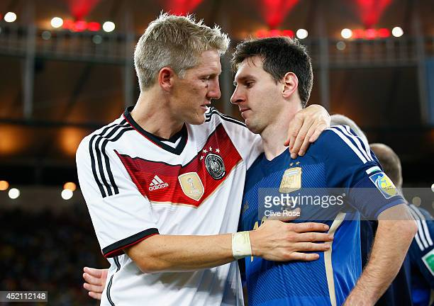 Bastian Schweinsteiger of Germany hugs Lionel Messi of Argentina after Germany's 10 victory in extra time during the 2014 FIFA World Cup Brazil Final...