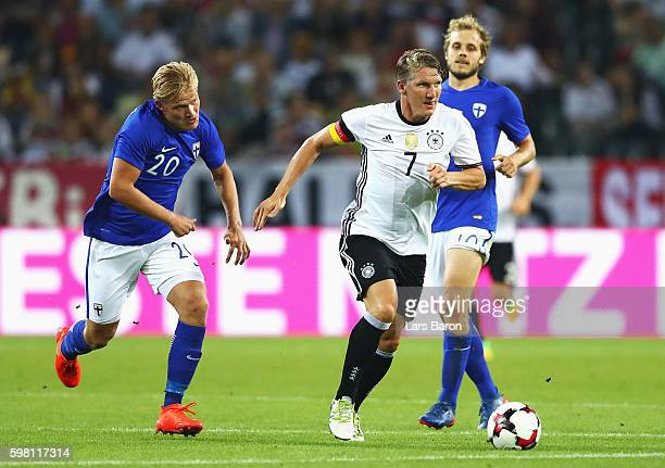 Bastian Schweinsteiger of Germany is closed down by Joel Pohjanpalo of Finland during the International Friendly match between Germany and Finland at...