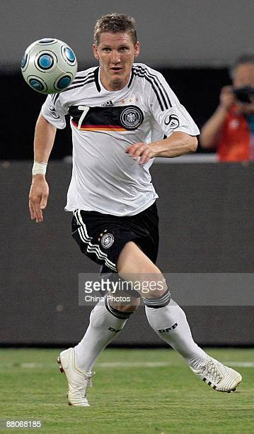 Bastian Schweinsteiger of Germany is shown in action during the international friendly match between China and Germany at Shanghai Stadium on May 29...