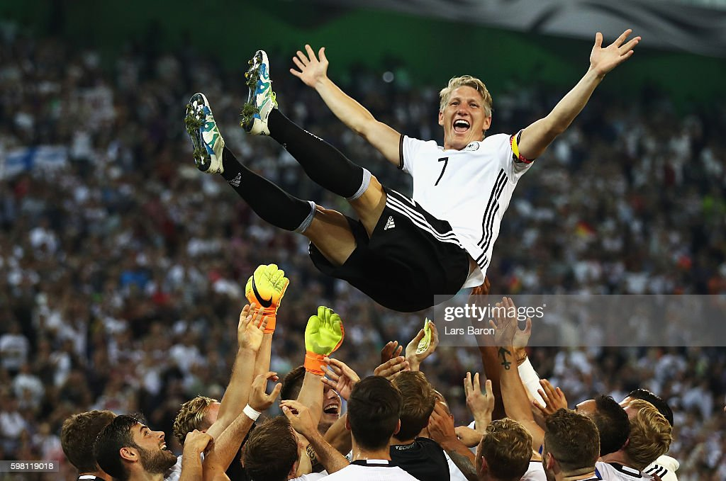 Bastian Schweinsteiger of Germany is thrown in to the air by team mates after his last international match during the International Friendly match between Germany and Finland at Borussia-Park on August 31, 2016 in Moenchengladbach, Germany.