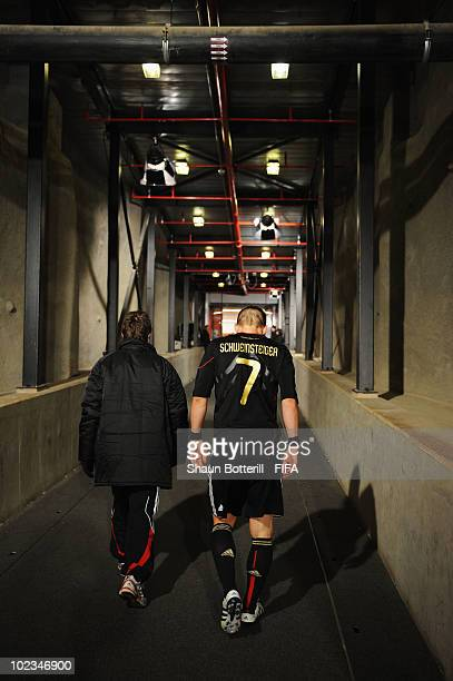 Bastian Schweinsteiger of Germany leaves the field after the 2010 FIFA World Cup South Africa Group D match between Ghana and Germany at Soccer City...