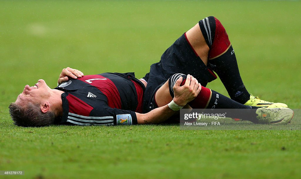 Bastian Schweinsteiger of Germany lies injured during the 2014 FIFA World Cup Brazil Group G match between USA and Germany at Arena Pernambuco on June 26, 2014 in Recife, Brazil.