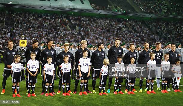 Bastian Schweinsteiger of Germany lines up with team mates in his last international match the International Friendly match between Germany and...