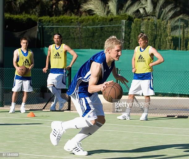 Bastian Schweinsteiger of Germany plays basketball with his team mates Philipp Lahm Kevin Kuranyi and Clemens Fritz at the Arabella Sheraton Son Vida...