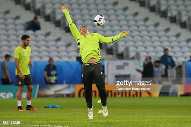 Bastian Schweinsteiger of Germany plays with the ball during a Germany training session at Stade PierreMauray ahead of their opening UEFA EURO 2016...