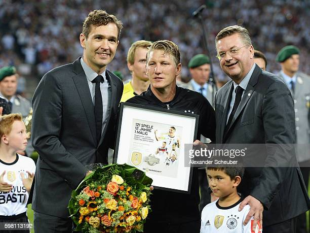 Bastian Schweinsteiger of Germany poses with Friedrich Curtius DFB Secretary General and Reinhard Grindel DFB President prior to his last...