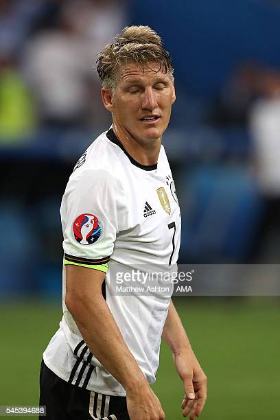 Bastian Schweinsteiger of Germany reacts after Antoine Griezmann of France scored a goal to make the score 0-2 during the UEFA Euro 2016 Semi Final...