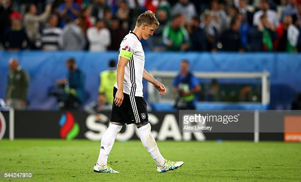 Bastian Schweinsteiger of Germany reacts after missing at the penalty shootout during the UEFA EURO 2016 quarter final match between Germany and...