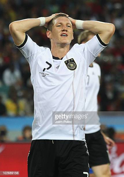 Bastian Schweinsteiger of Germany reacts to a missed chance during the 2010 FIFA World Cup South Africa Semi Final match between Germany and Spain at...