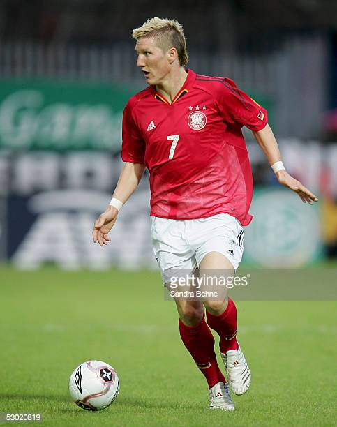 Bastian Schweinsteiger of Germany runs after the ball during the friendly match between Northern Ireland and Germany on June 4 2005 in Belfast...