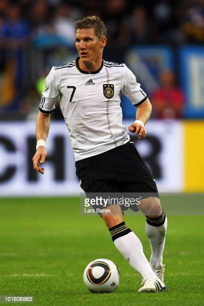 Bastian Schweinsteiger of Germany runs with the ball during the international friendly match between Germany and Bosnia-Herzegovina at Commerzbank...