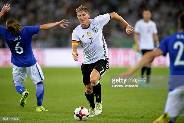 Bastian Schweinsteiger of Germany runs with the ball during the international friendly match between Germany and Finland at BorussiaPark on August 31...