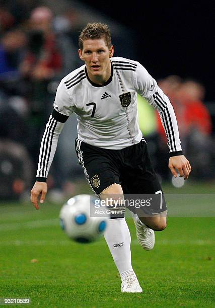 Bastian Schweinsteiger of Germany runs with the ball during the International friendly match between Germany and the Ivory Coast at the Schalke Arena...