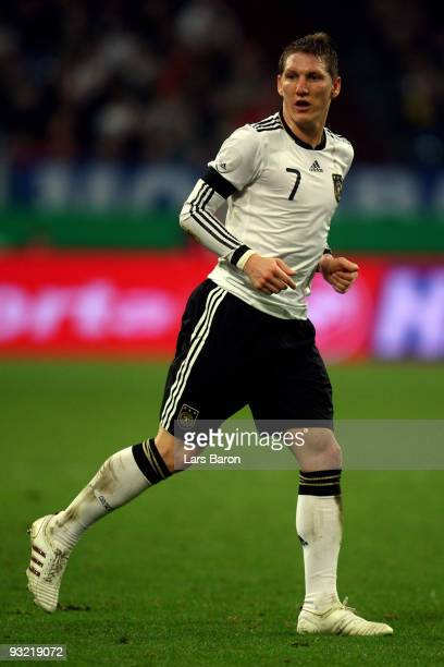 Bastian Schweinsteiger of Germany runs with the ball during the International Friendly match between Germany and Ivory Coast at the Schalke Arena on...