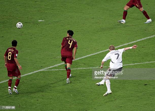 Bastian Schweinsteiger of Germany scores his sides third goal during the FIFA World Cup Germany 2006 Third Place Play-off match between Germany and...