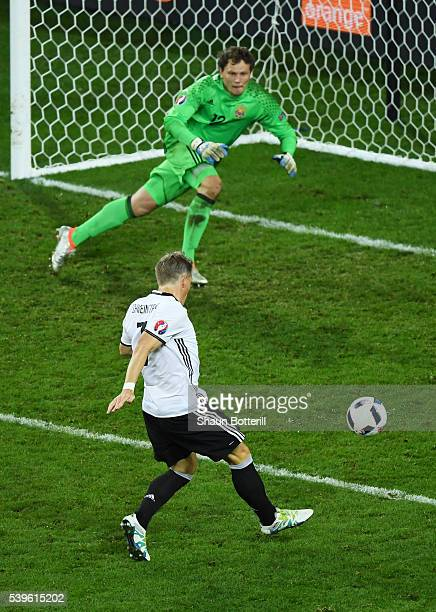 Bastian Schweinsteiger of Germany scores his team's second goal during the UEFA EURO 2016 Group C match between Germany and Ukraine at Stade...