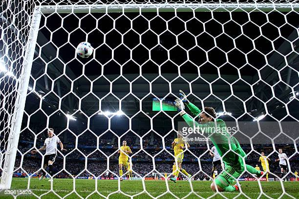 Bastian Schweinsteiger of Germany scores his team's second goal past Andriy Pyatov of Ukraine during the UEFA EURO 2016 Group C match between Germany...