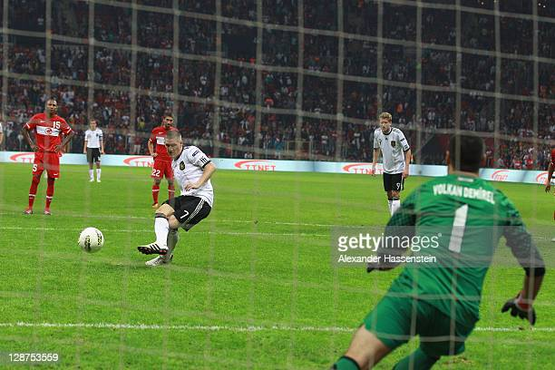 Bastian Schweinsteiger of Germany scores the 3rd goal with a penalty kick during the UEFA EURO 2012 Group A qualifying match between Turkey and...