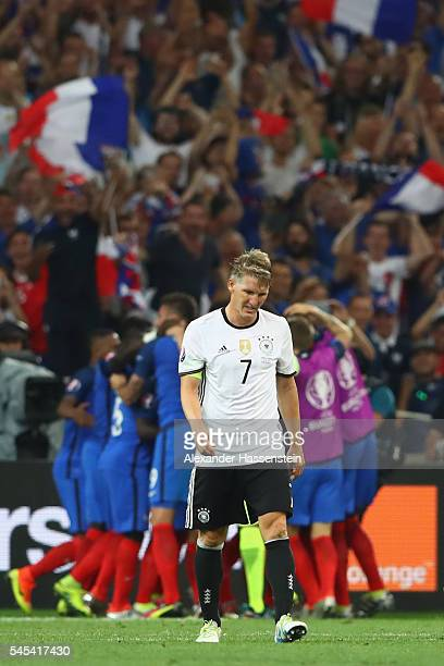 Bastian Schweinsteiger of Germany shows his dejection after France's second goal during the UEFA EURO semi final match between Germany and France at...