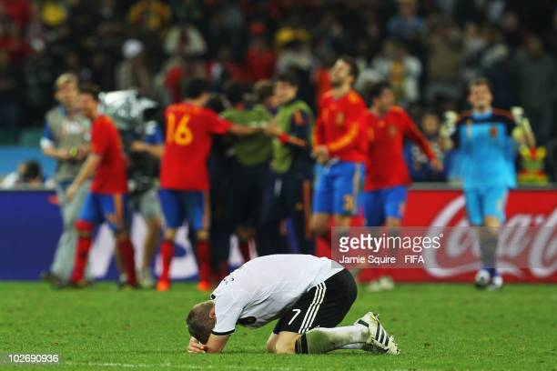 Bastian Schweinsteiger of Germany shows his dejection at the end of the 2010 FIFA World Cup South Africa Semi Final match between Germany and Spain...