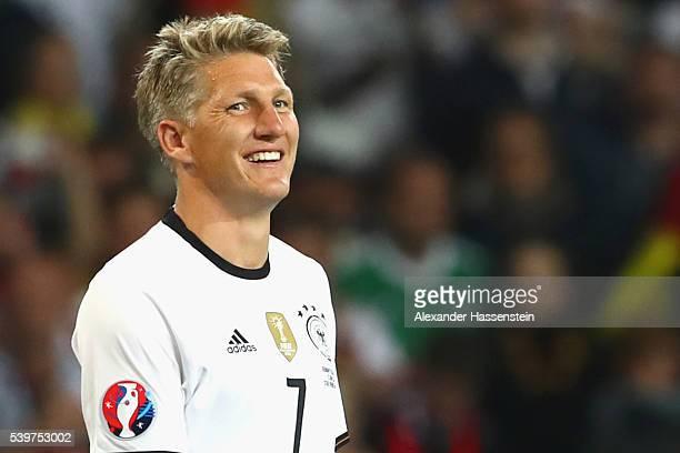 Bastian Schweinsteiger of Germany smiles during the UEFA EURO 2016 Group C match between Germany and Ukraine at Stade PierreMauroy on June 12 2016 in...