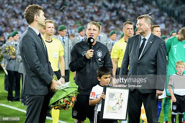 Bastian Schweinsteiger of Germany talks with Friedrich Curtius DFB Secretary General and Reinhard Grindel DFB President prior to his last...