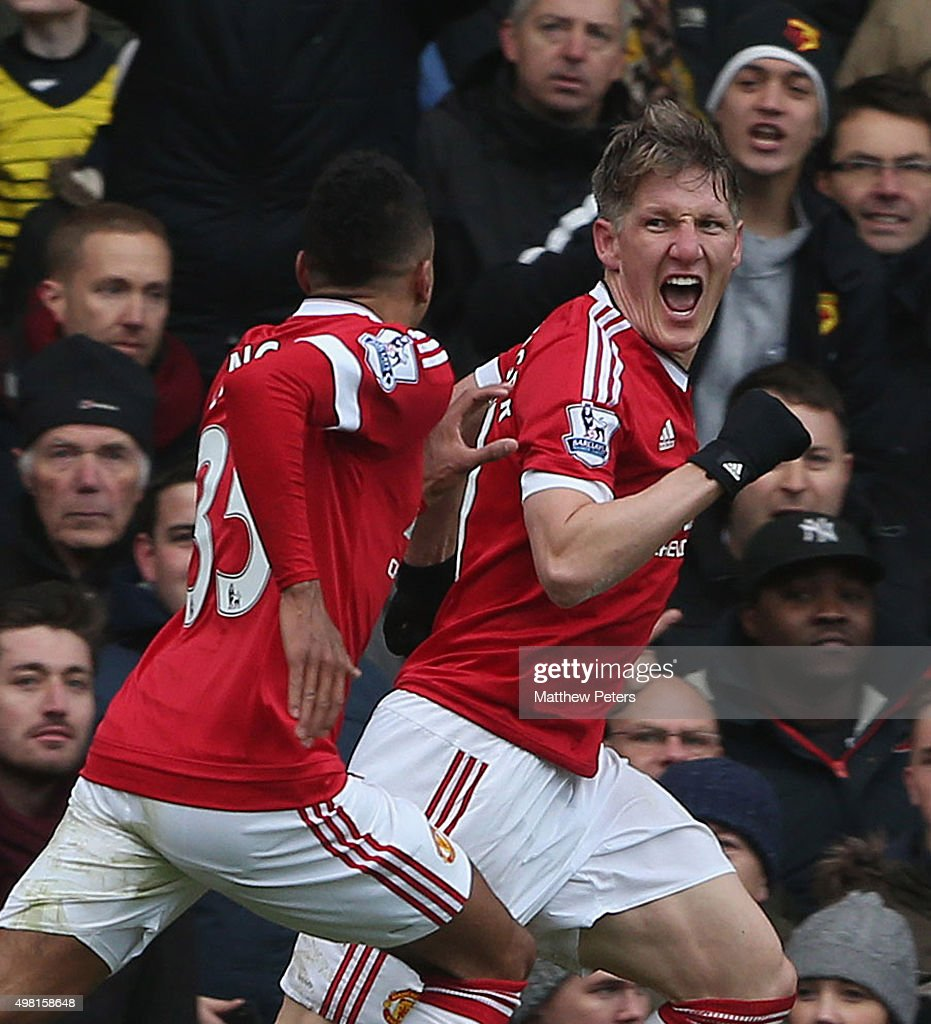 Bastian Schweinsteiger (R) of Manchester United celebrates his part in Troy Deeney of Watford scoring an own-goal during the Barclays Premier League match between Watford and Manchester United at Vicarage Road on November 21, 2015 in Watford, England.