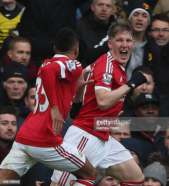 Bastian Schweinsteiger of Manchester United celebrates his part in Troy Deeney of Watford scoring an own-goal during the Barclays Premier League...
