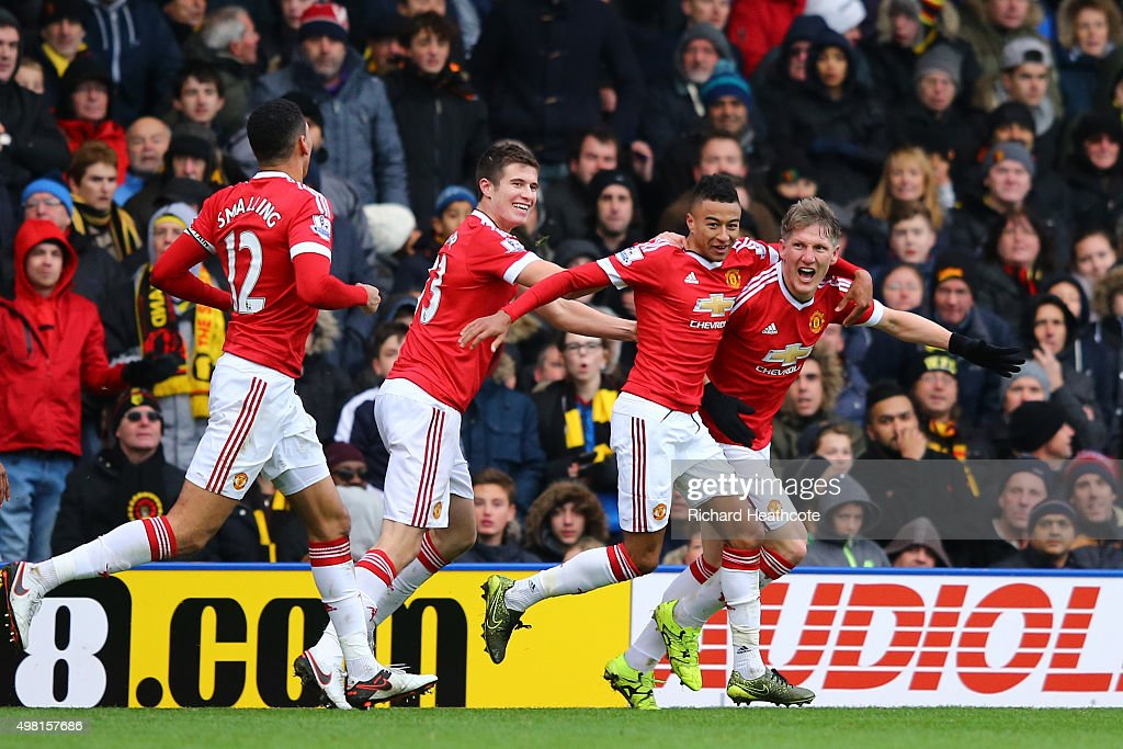 Bastian Schweinsteiger of Manchester United celebrates his team's second goal scored by Troy Deeney of Watford with his team mates during the Barclays Premier League match between Watford and Manchester United at Vicarage Road on November 21, 2015 in Watford, England.