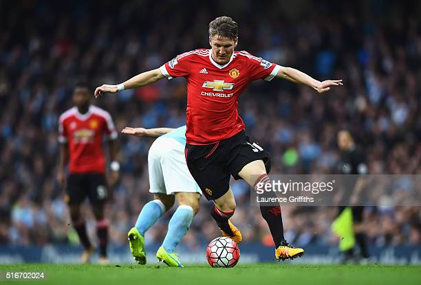 Bastian Schweinsteiger of Manchester United evades Sergio Aguero of Manchester City during the Barclays Premier League match between Manchester City...