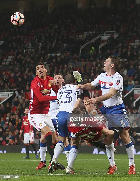 Bastian Schweinsteiger of Manchester United in action with Stephen Warnock and Jake Buxtonof Wigan Athletic during the Emirates FA Cup Fourth Round...
