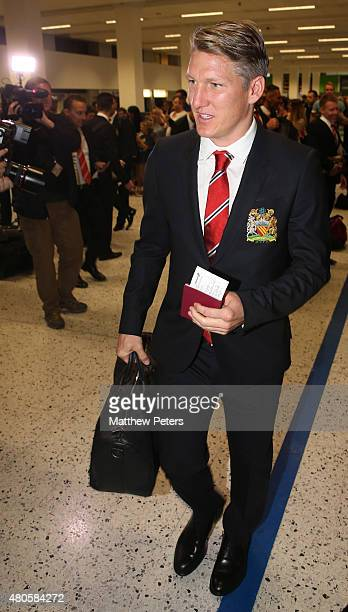 Bastian Schweinsteiger of Manchester United leaves for the club's preseason tour of the USA at Manchester Airport on July 13 2015 in Manchester...