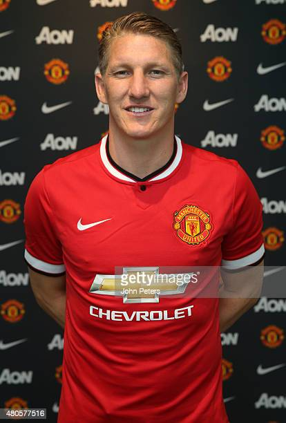 Bastian Schweinsteiger of Manchester United poses after signing for the club at Aon Training Complex on July 13 2015 in Manchester England
