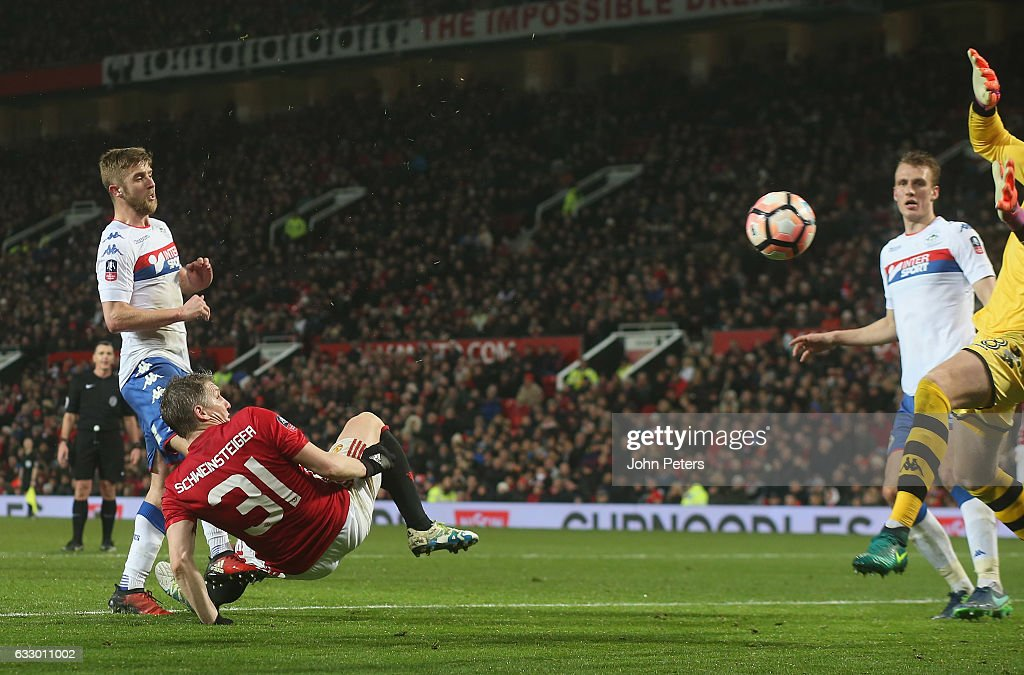 Bastian Schweinsteiger of Manchester United scores their fourth goal during the Emirates FA Cup Fourth Round match between Manchester United and Wigan Athletic at Old Trafford on January 29, 2017 in Manchester, England.