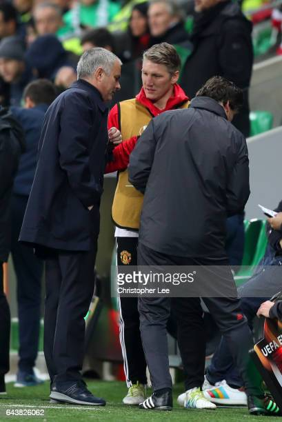 Bastian Schweinsteiger of Manchester United speaks with Jose Mourinho manager of Manchester United on the touchline during the UEFA Europa League...