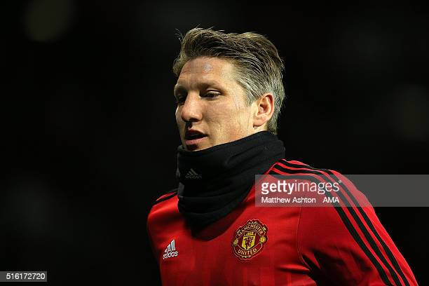 Bastian Schweinsteiger of Manchester United warms up prior to the UEFA Europa League Round of 16 Second Leg match between Manchester United and...