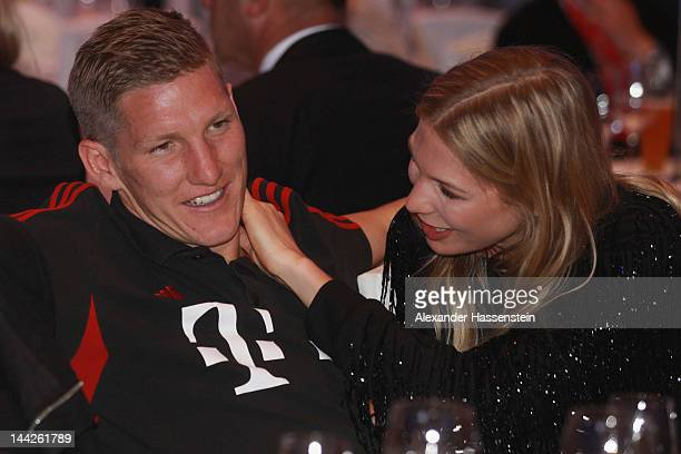 Bastian Schweinsteiger of Muenchen and Sarah Brandner during the Bayern Muenchen party at Telekom representative office on May 13 2012 in Berlin...