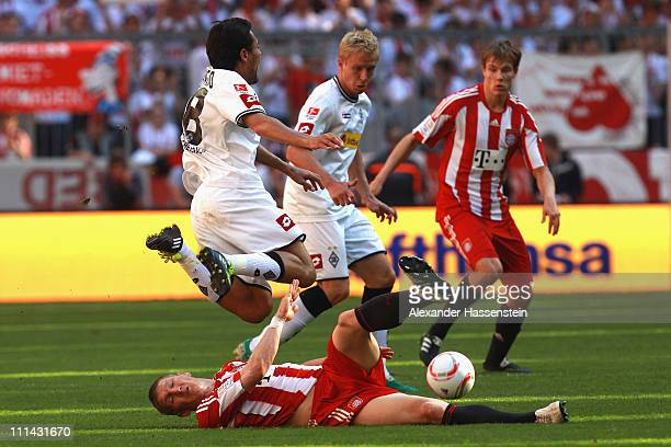 Bastian Schweinsteiger of Muenchen battles for the ball with Juan Arango of Gladbach during the Bundesliga match between FC Bayern Muenchen and...
