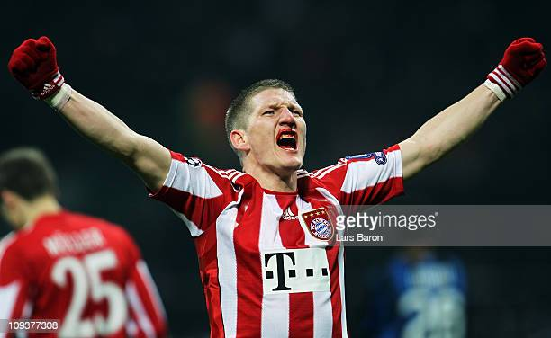 Bastian Schweinsteiger of Muenchen celebrates after team mate MArio Gomez scored the winning goal during the UEFA Champions League round of 16 first...