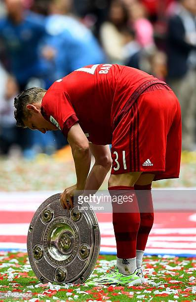 Bastian Schweinsteiger of Muenchen celebrates after winning the league after the Bundesliga match between FC Bayern Muenchen and 1. FSV Mainz at...