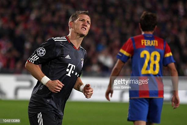Bastian Schweinsteiger of Muenchen celebrates his team's first goal during the UEFA Champions League group E match between FC Basel and FC Bayern...