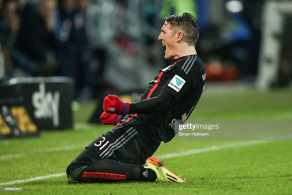 Bastian Schweinsteiger of Muenchen celebrates his team's first goal during the Bundesliga match between 1. FSV Mainz 05 and FC Bayern Muenchen at Coface Arena on December 19, 2014 in Mainz, Germany.