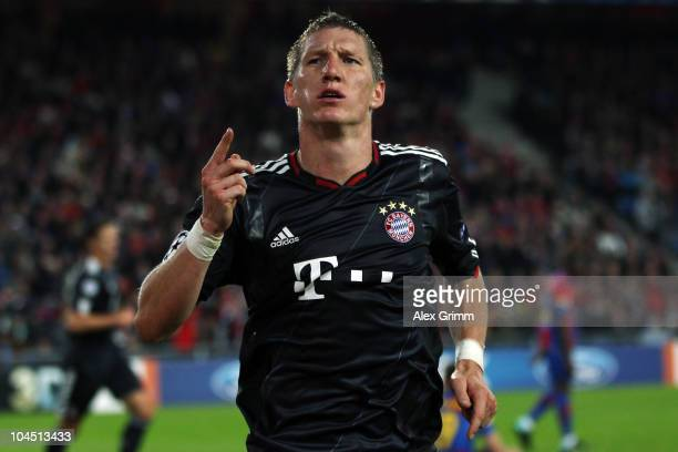 Bastian Schweinsteiger of Muenchen celebrates his team's second goal during the UEFA Champions League group E match between FC Basel and FC Bayern...