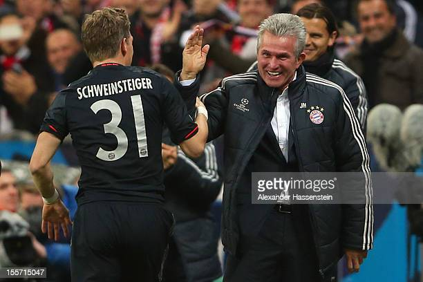 Bastian Schweinsteiger of Muenchen celebrates scoring the opening goal with his head coach Jupp Henyckes during the UEFA Champions League group F...