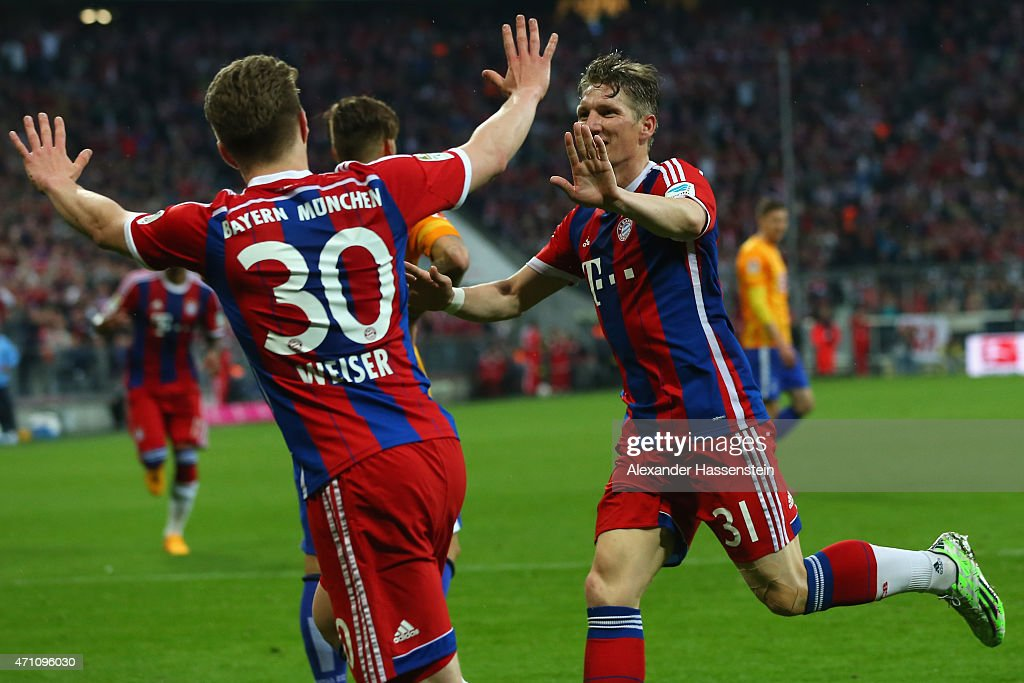 Bastian Schweinsteiger of Muenchen celebrates scoring the opening goal with his team mate Mitchell Weiser during the Bundesliga match between FC Bayern Muenchen and Hertha BSC Berlin at Allianz Arena on April 25, 2015 in Munich, Germany.