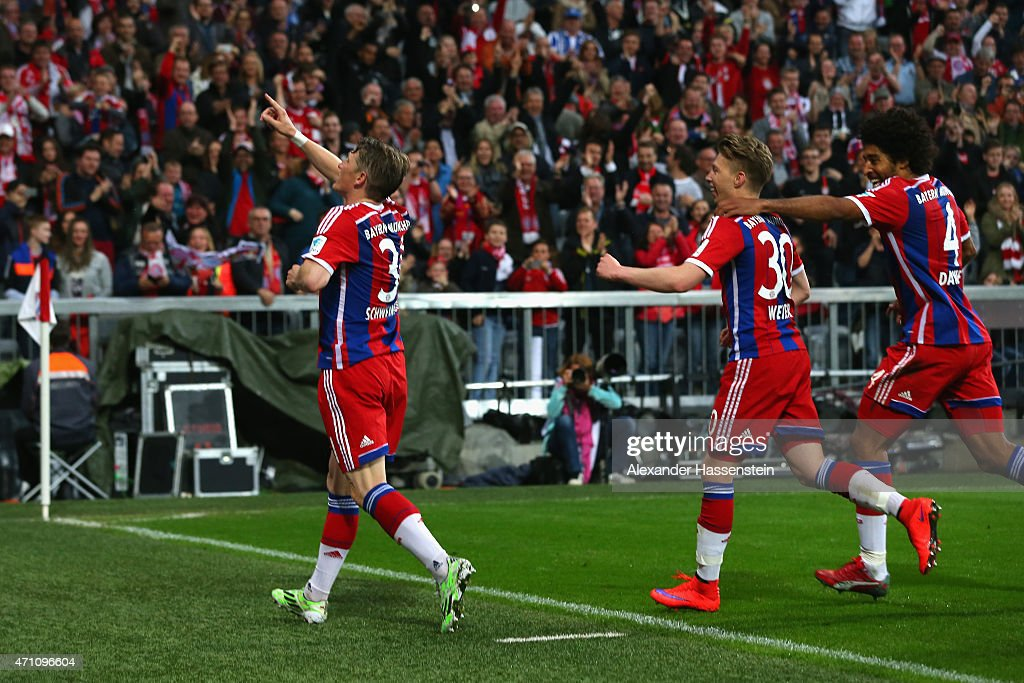 Bastian Schweinsteiger (L) of Muenchen celebrates scoring the opening goal during the Bundesliga match between FC Bayern Muenchen and Hertha BSC Berlin at Allianz Arena on April 25, 2015 in Munich, Germany.