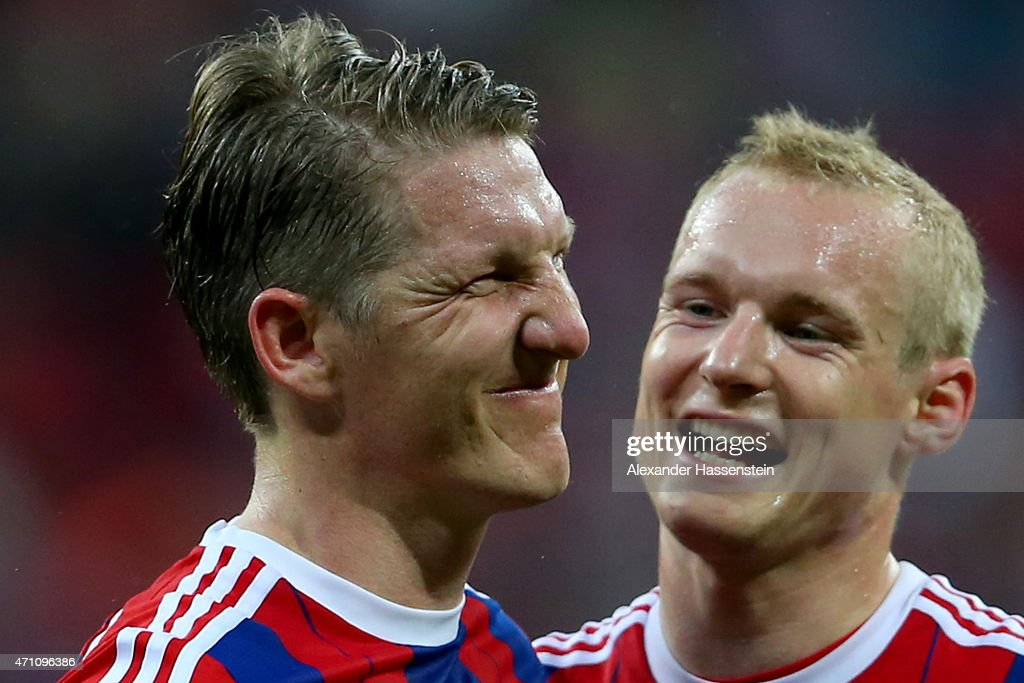 Bastian Schweinsteiger of Muenchen celebrates with his team mate Sebastian Rode (R) after the Bundesliga match between FC Bayern Muenchen and Hertha BSC Berlin at Allianz Arena on April 25, 2015 in Munich, Germany.