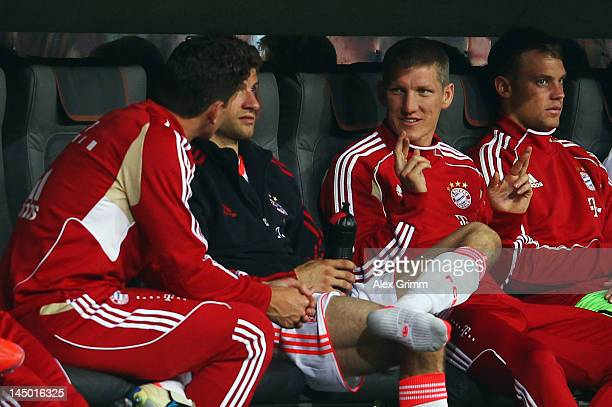 Bastian Schweinsteiger of Muenchen chats with team mates Mario Gomez Thomas Mueller and Manuel Neuer during the friendly match between FC Bayern...
